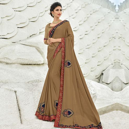 Blooming Chiku Colored Partywear Embroidered Georgette Saree