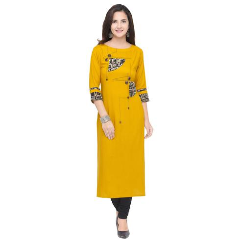 Eye-catching Yellow Colored Partywear Heavy Rayon Fancy Kurti