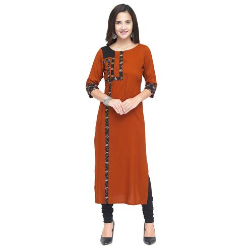 Majesty Rust Orange Colored Partywear Heavy Rayon Fancy Kurti