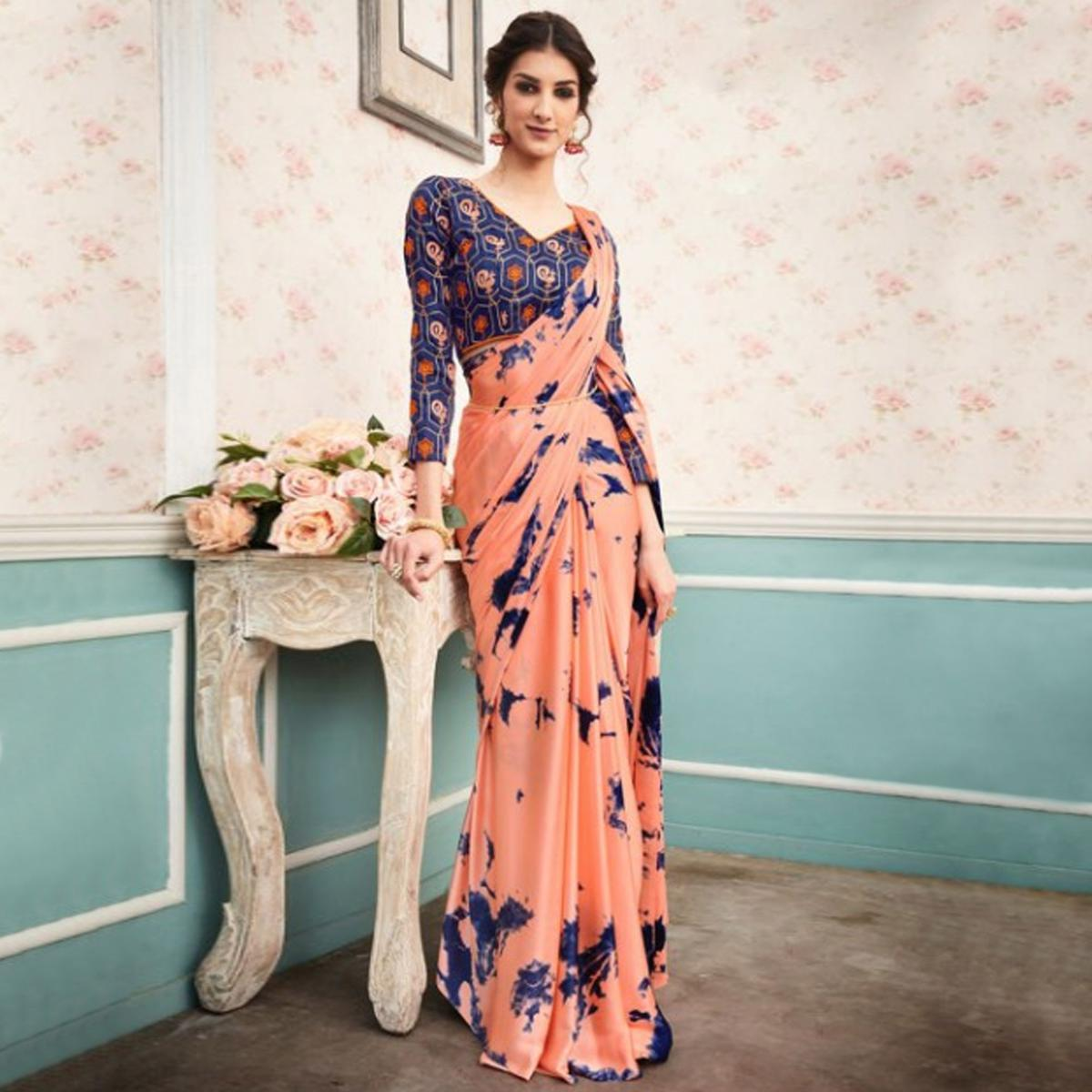 Gorgeous Peach Colored Partywear Printed Silk Saree
