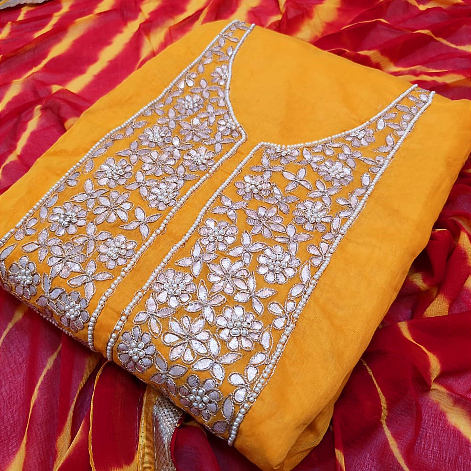 Graceful Yellow Colored Partywear Embroidered Modal Dress Material
