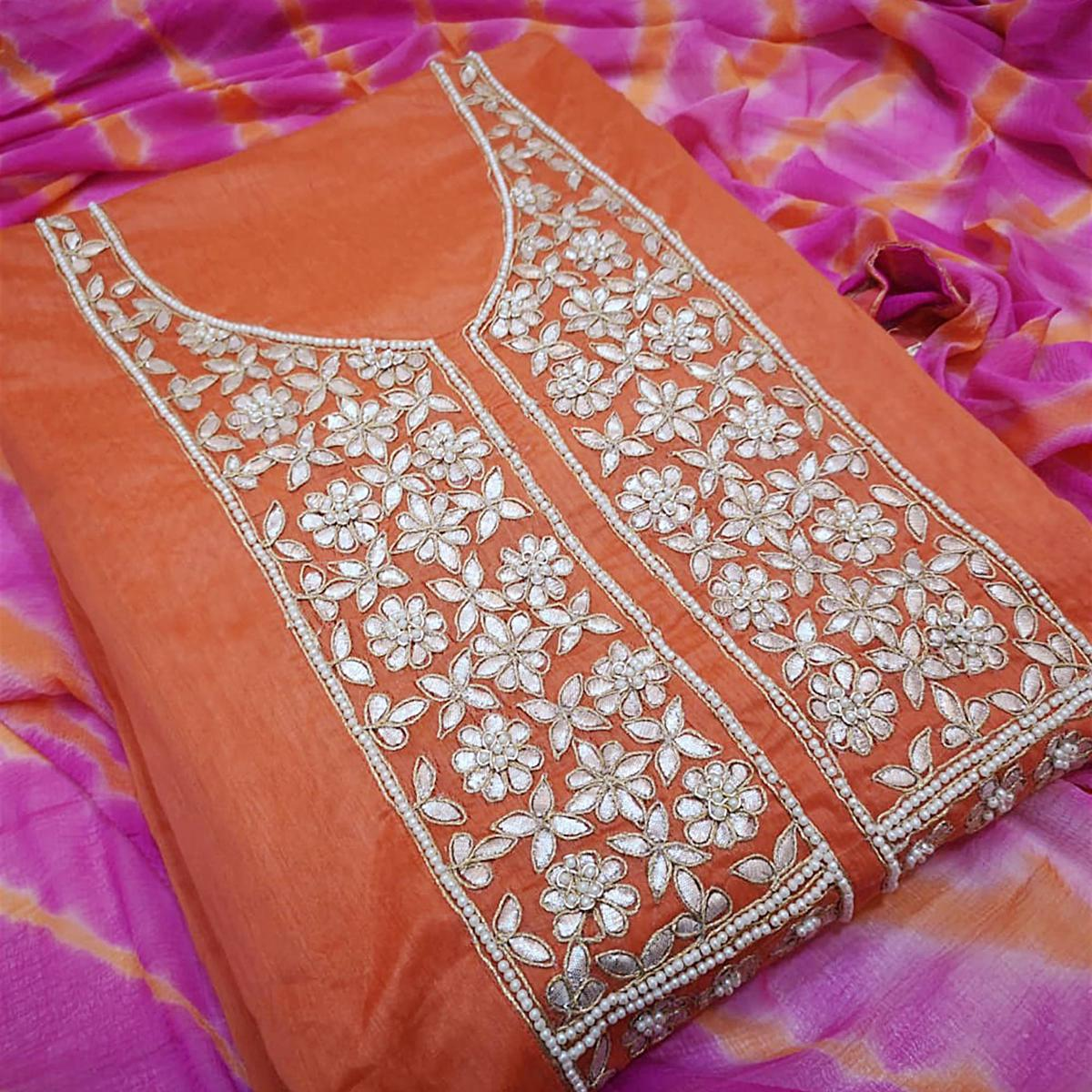 Lovely Orange Colored Partywear Embroidered Modal Dress Material