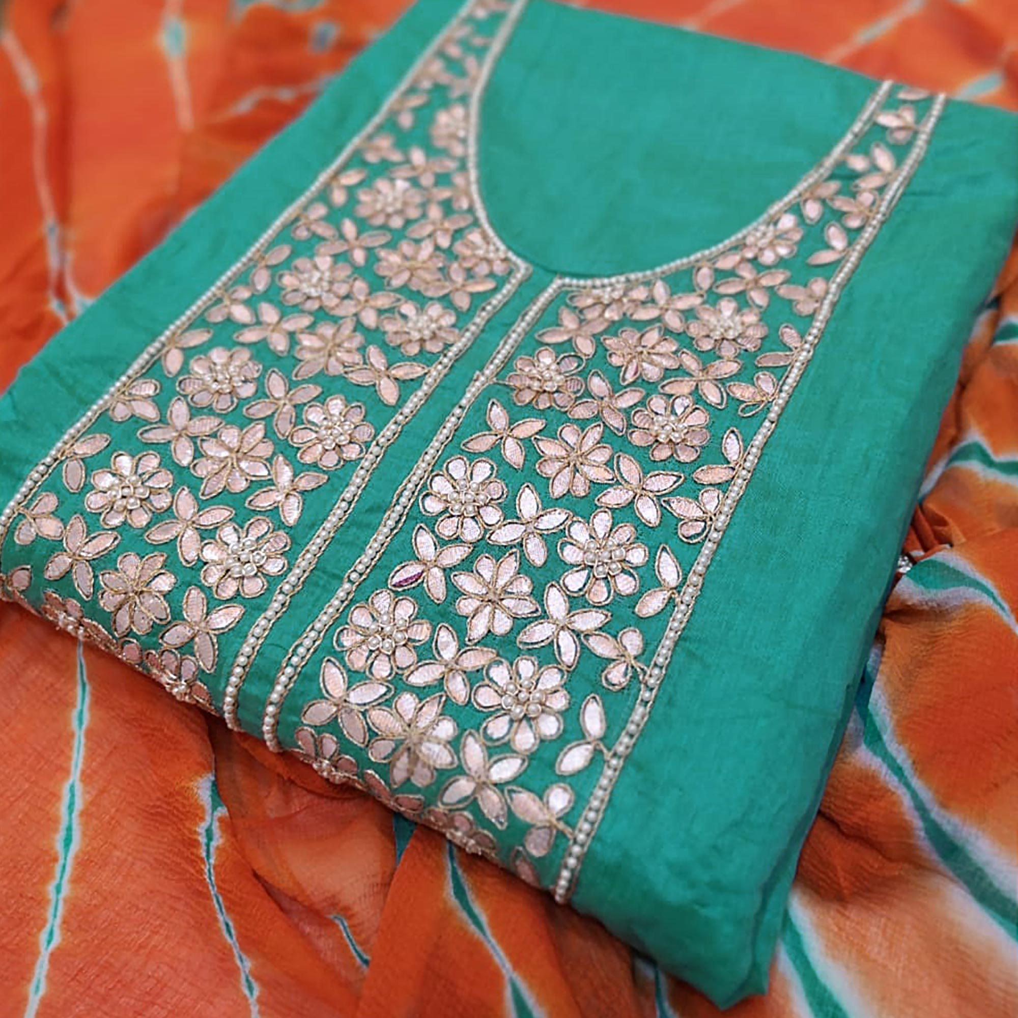 Alluring Turquoise Green Colored Partywear Embroidered Modal Dress Material