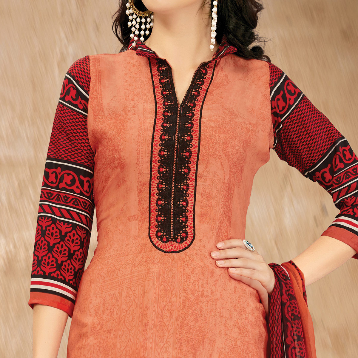 Glowing Peach Colored Casual Printed Crape Dress Material