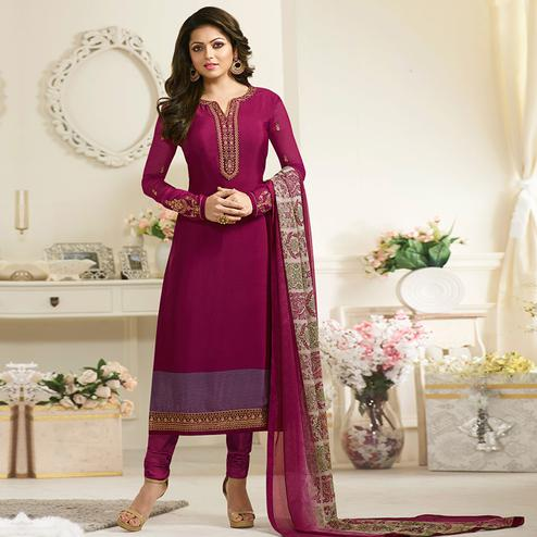 Imposing Magenta Colored Party Wear Embroidered Crape Suit
