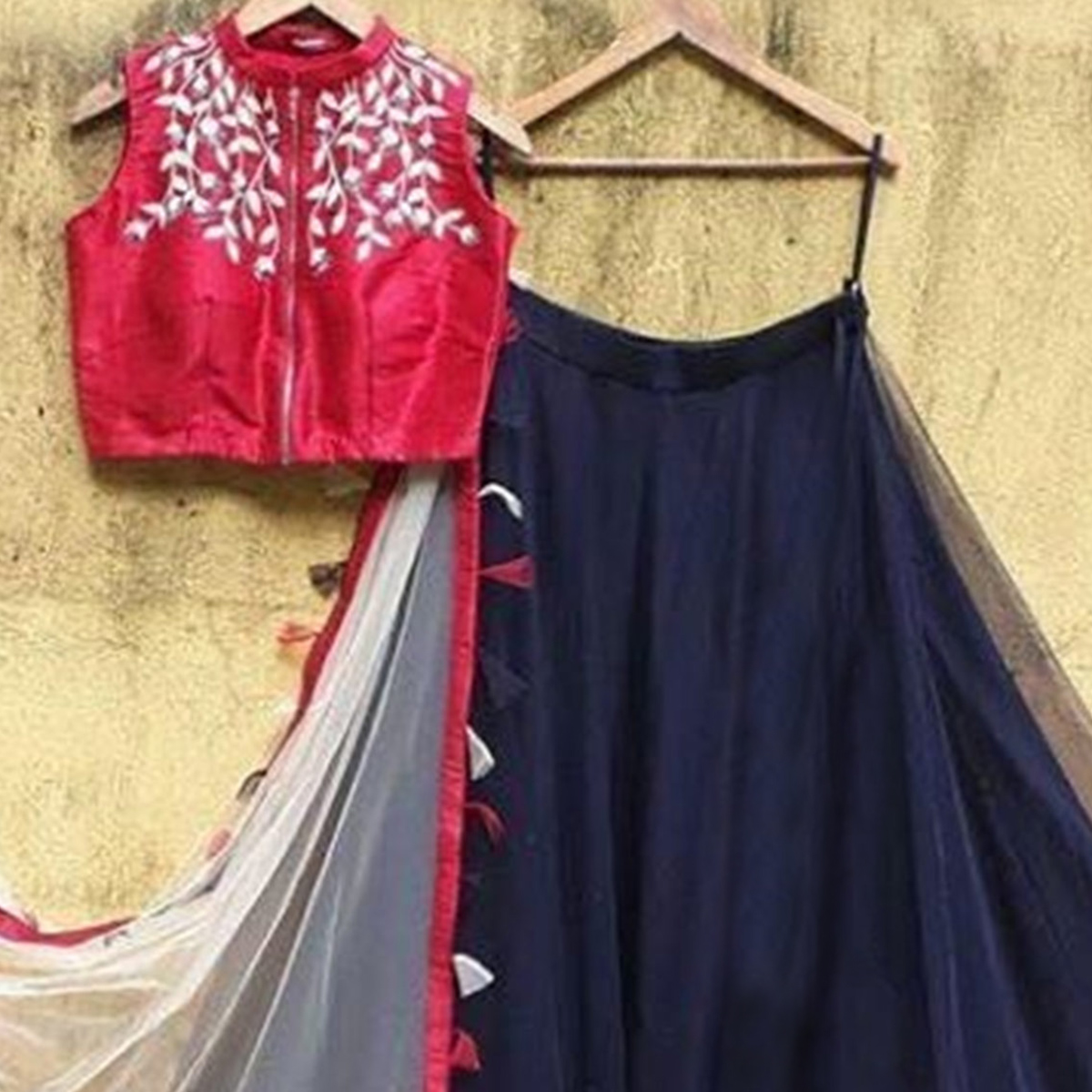 Gorgeous Navy Blue-Red Colored Partywear Embroidered Netted Lehenga Choli