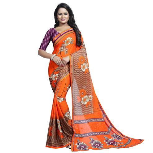 Flattering Orange Colored Casual Wear Printed Georgette Saree