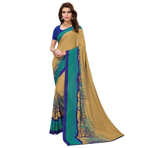 Mesmeric Chiku Colored Casual Wear Printed Georgette Saree