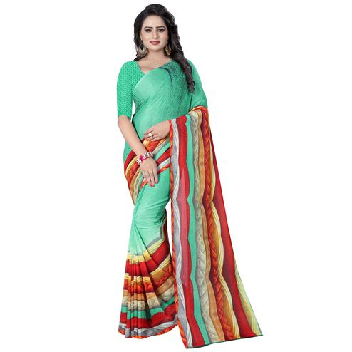 Adorning Turquoise Green Colored Casual Wear Printed Georgette Saree