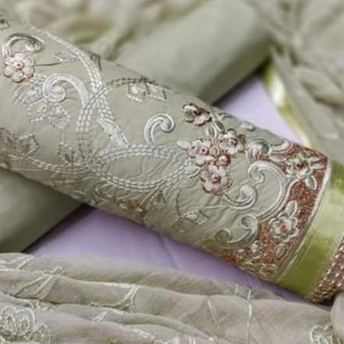Appealing Light Green Colored Partywear Embroidered Cotton Dress Material