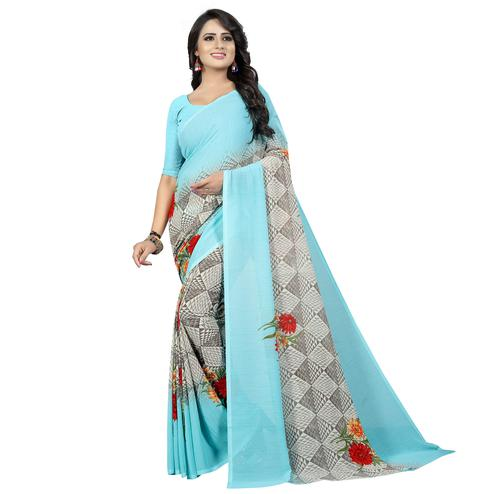 Groovy Sky Blue Colored Casual Wear Printed Georgette Saree