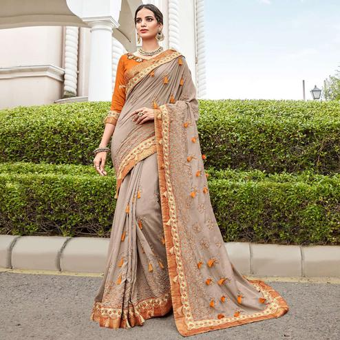 Flamboyant Gray Colored Partywear Embroidered Georgette Saree