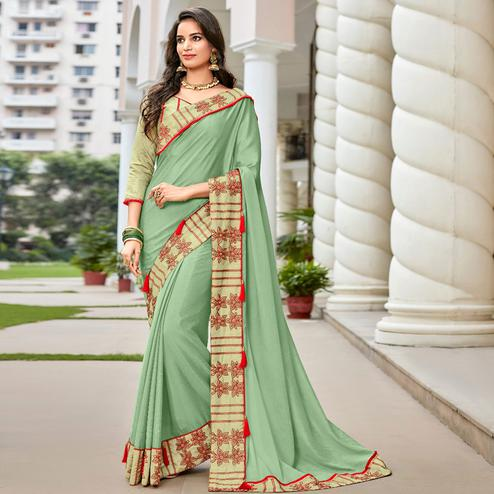 Flaunt Green Colored Partywear Embroidered Georgette Saree