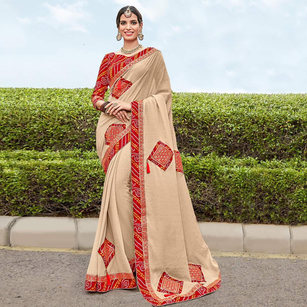 Trendy Beige Colored Partywear Embroidered Georgette Saree