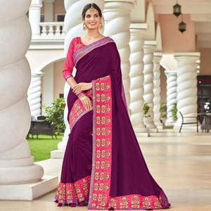 Glowing Violet Colored Partywear Embroidered Georgette Saree