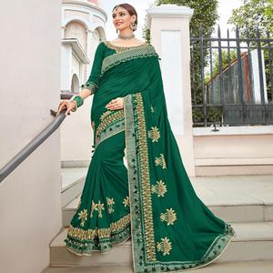 Exceptional Dark Green Colored Partywear Embroidered Georgette Saree