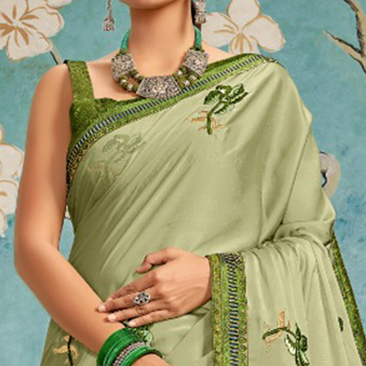 Sophisticated Light Green Colored Party Wear Embroidered Georgette Saree