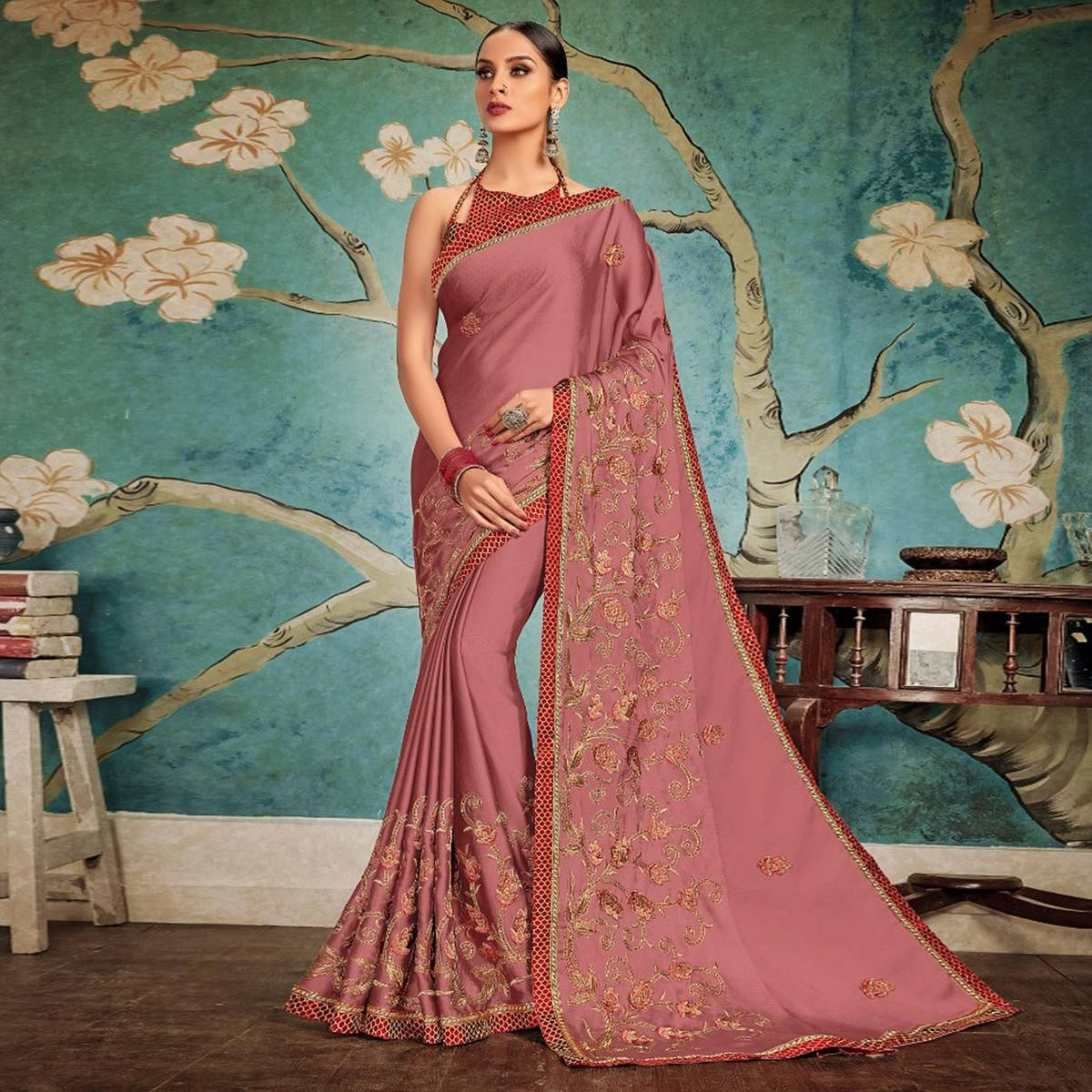 Opulent Dark Mauve Colored Party Wear Embroidered Georgette Saree