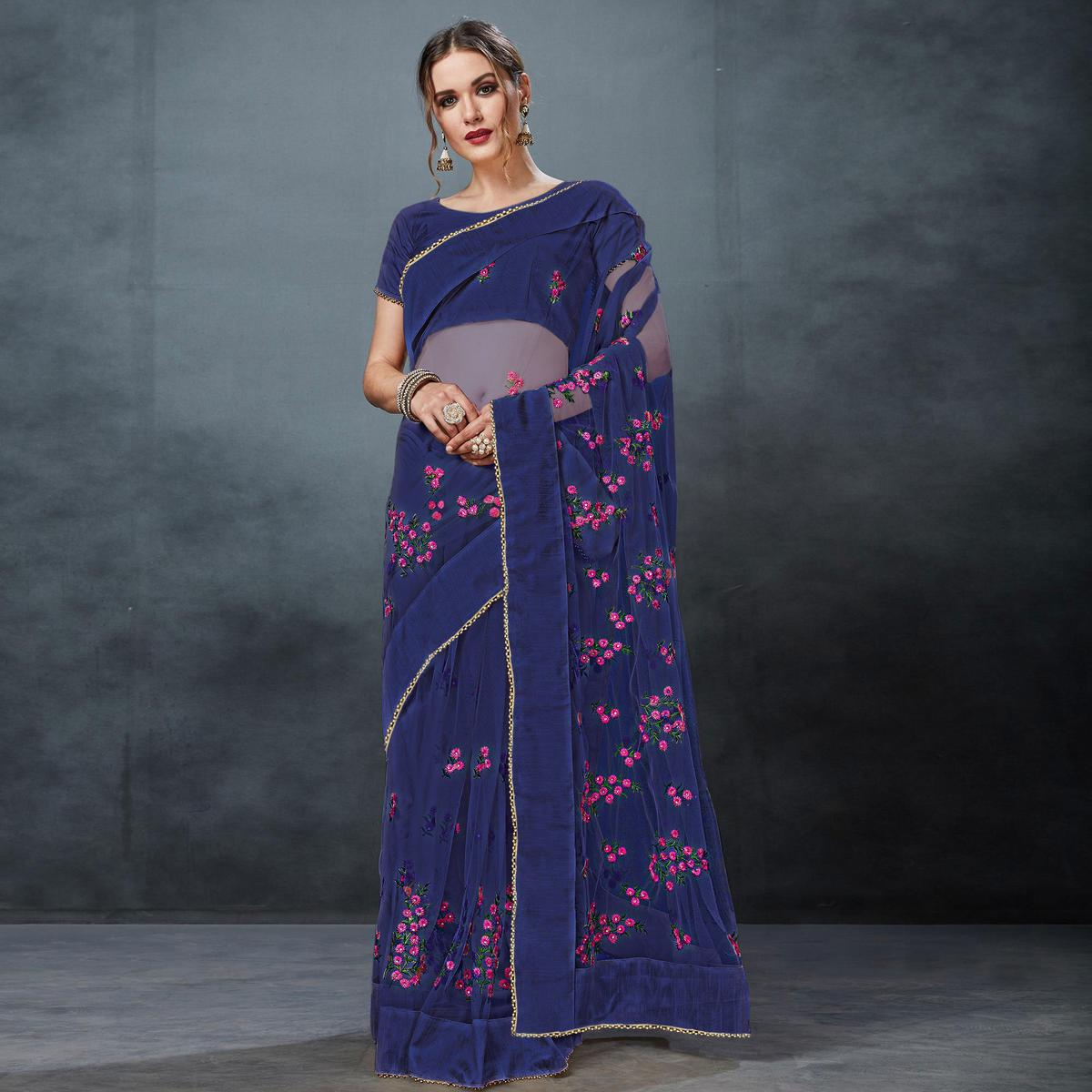 Gorgeous Blue Colored Partywear Embroidered Netted Saree