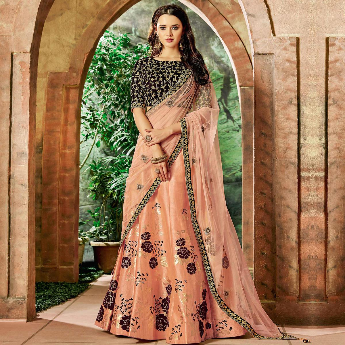 Radiant Peach Colored Partywear Embroidered Silk Lehenga Choli