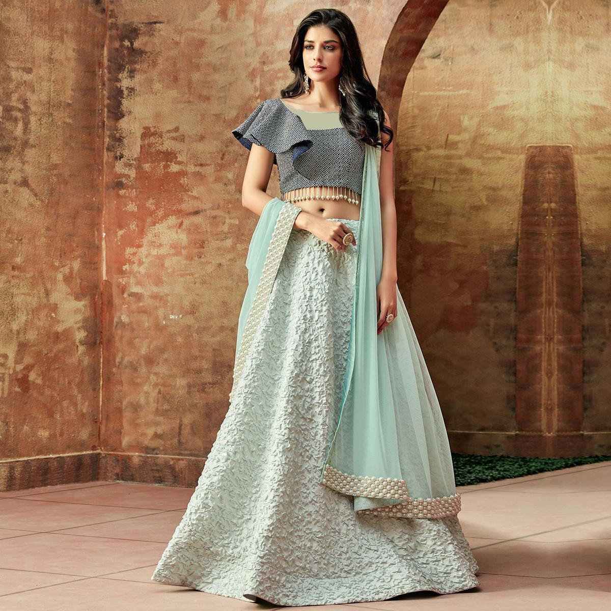 Opulent Sky Blue Colored Partywear Embroidered Art Silk Lehenga Choli