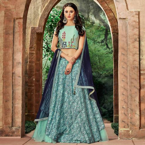 Breathtaking Sea Blue Colored Partywear Embroidered Silk-Net Lehenga Choli