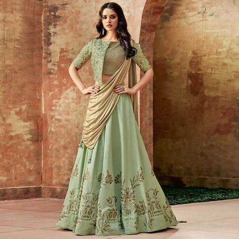 Impressive Pastel Green Colored Partywear Embroidered Silk Lehenga Choli
