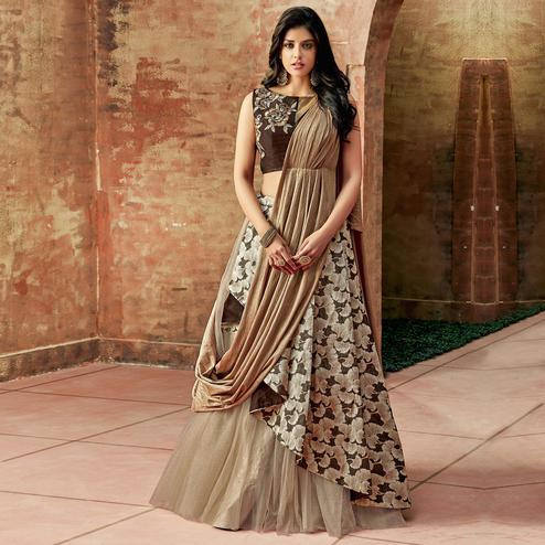 Gleaming Chiku Colored Partywear Embroidered Jacquard Silk-Net Lehenga Choli