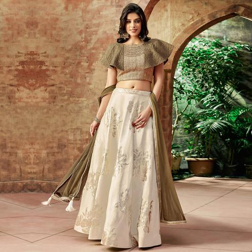 Exceptional Cream Colored Partywear Embroidered Jacquard Silk Lehenga Choli