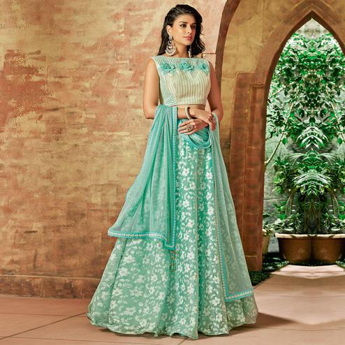 Excellent Sea Green Colored Partywear Embroidered Tissue Lehenga Choli