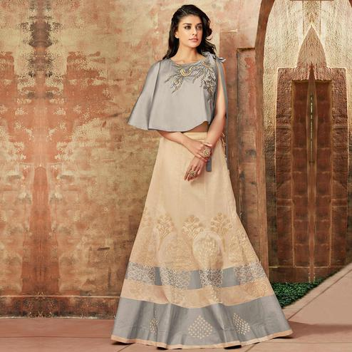 Flirty Cream Colored Partywear Embroidered Silk Lehenga Choli