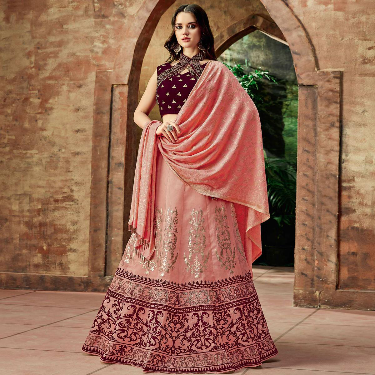 Glowing Pink Colored Partywear Embroidered Silk Lehenga Choli