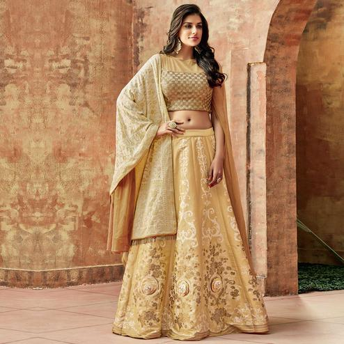 Magnetic Beige Colored Partywear Embroidered Silk Lehenga Choli