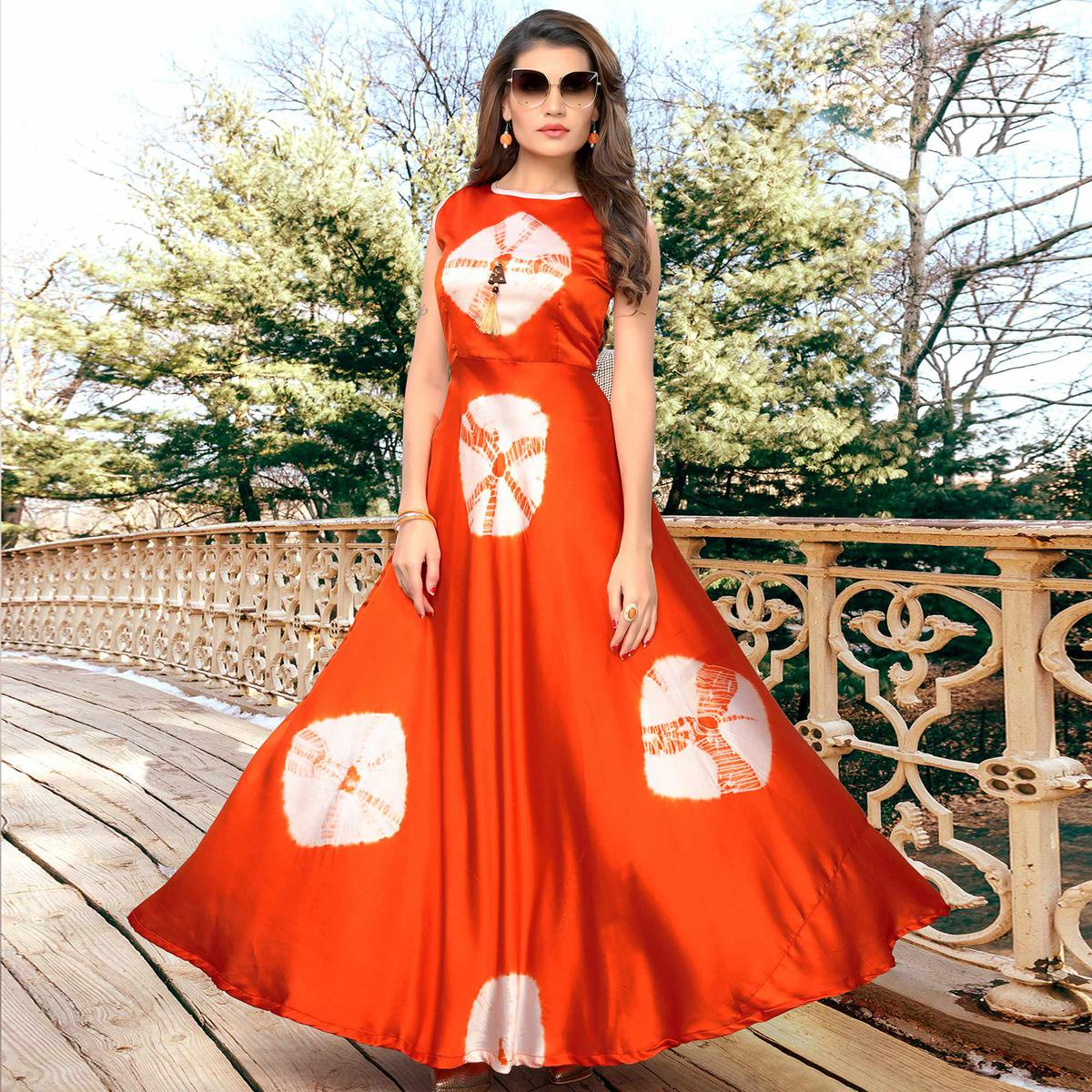 Exceptional Orange Colored Partywear Shibori Printed Satin Long Kurti