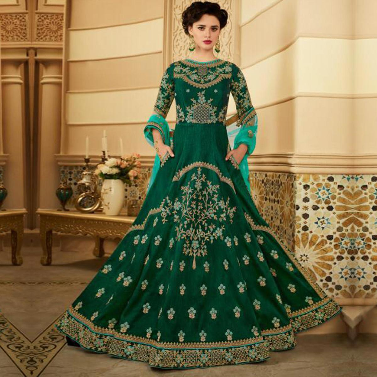 Stunning Dark Green Colored Partywear Embroidered Silk Anarkali Suit
