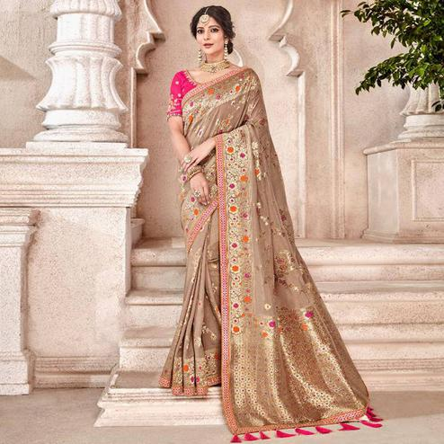 Flattering Chiku Colored Partywear Woven Viscose Saree