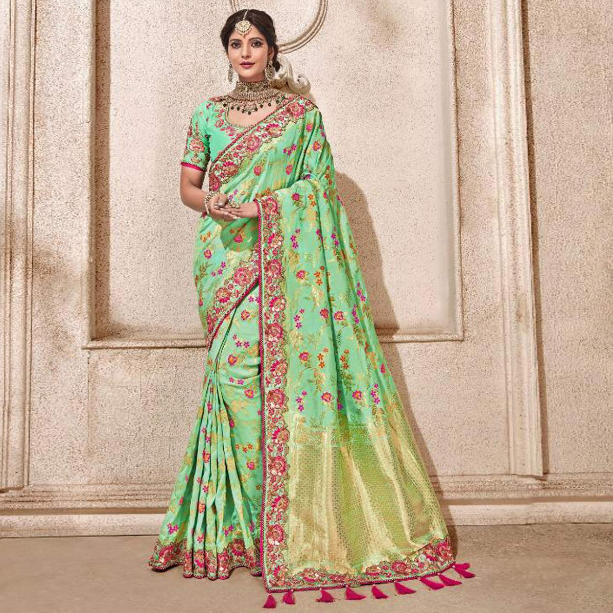 Arresting Turquoise Green Colored Partywear Woven Viscose Saree