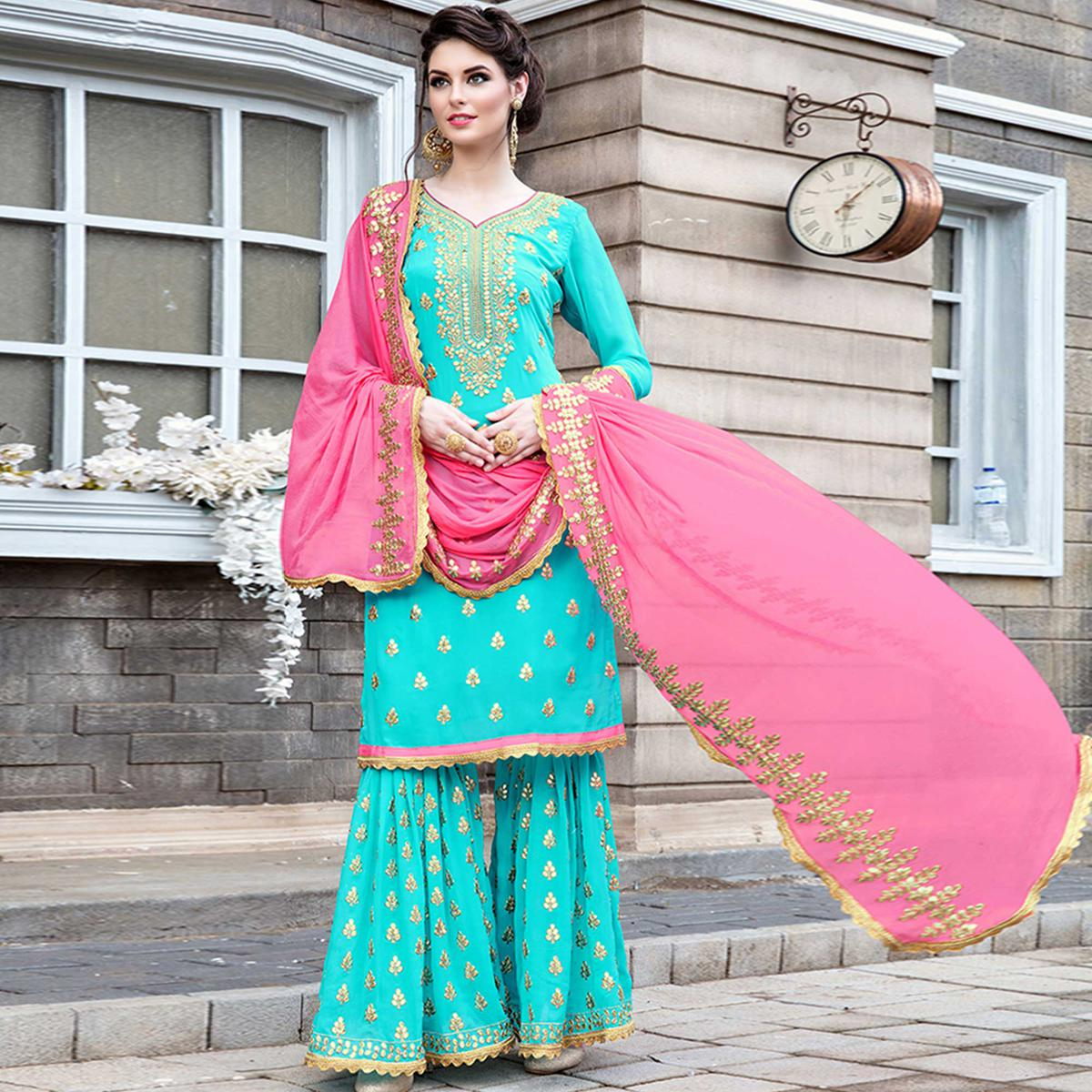 Demanding Aqua Blue Colored Party Wear Embroidered Georgette Palazzo Suit