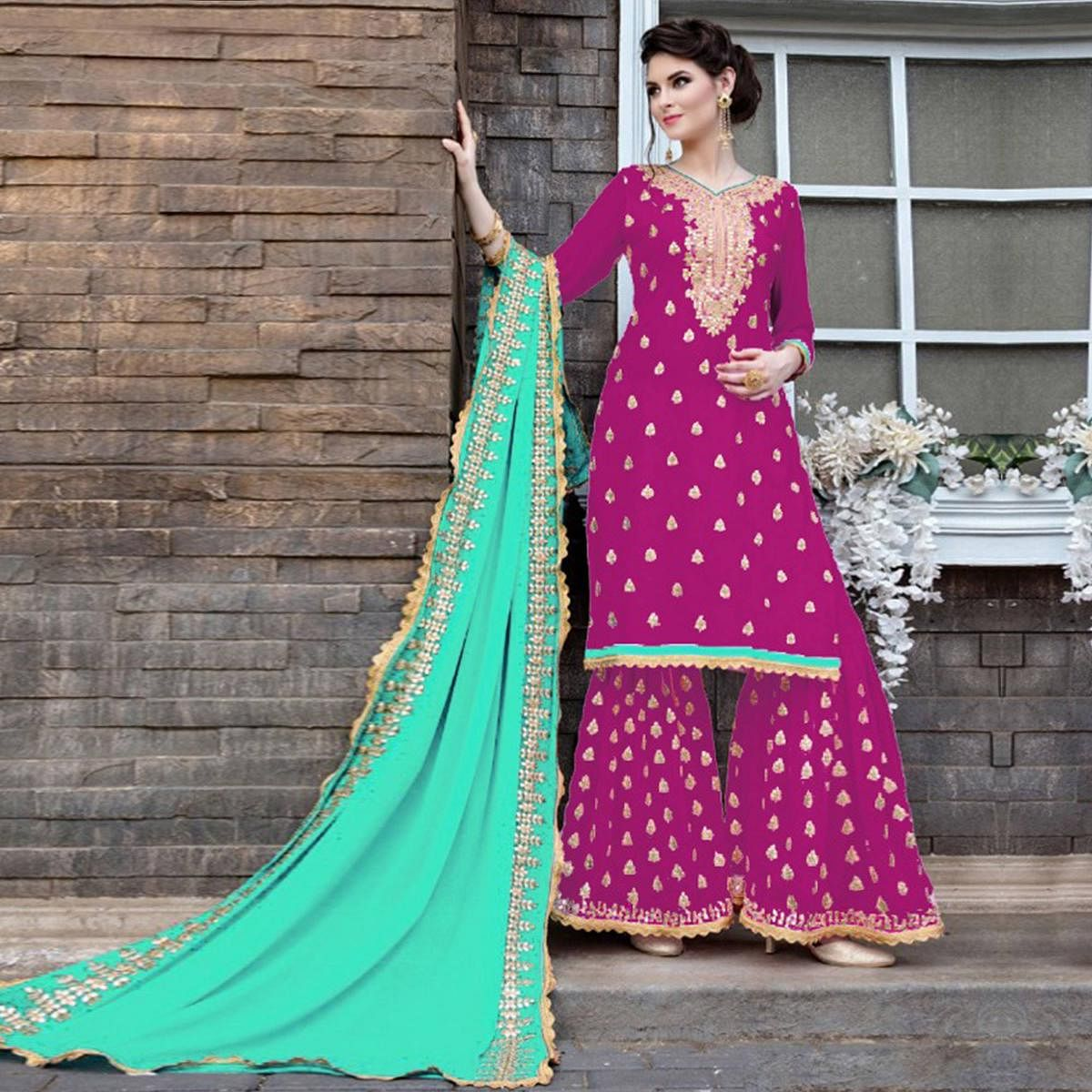 Opulent Magenta Pink Colored Party Wear Embroidered Georgette Palazzo Suit