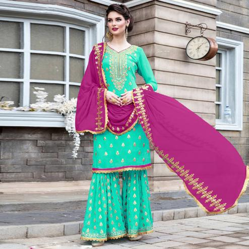 Dazzling Mint Green Colored Party Wear Embroidered Georgette Palazzo Suit