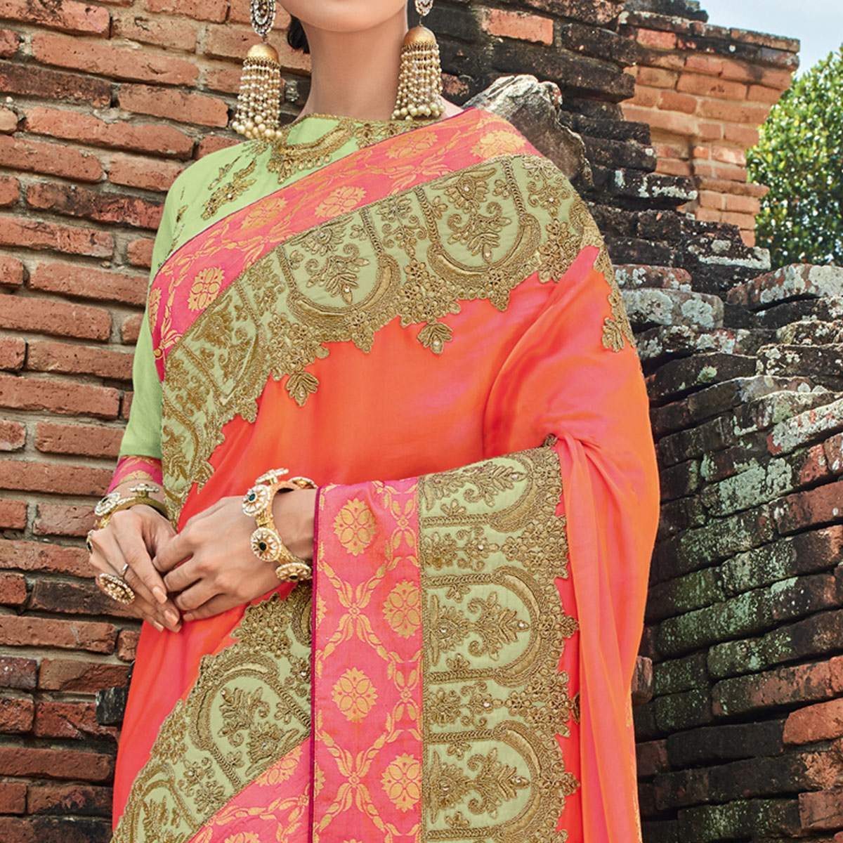 Gleaming Orange Colored Party Wear Embroidered Raw Silk Saree