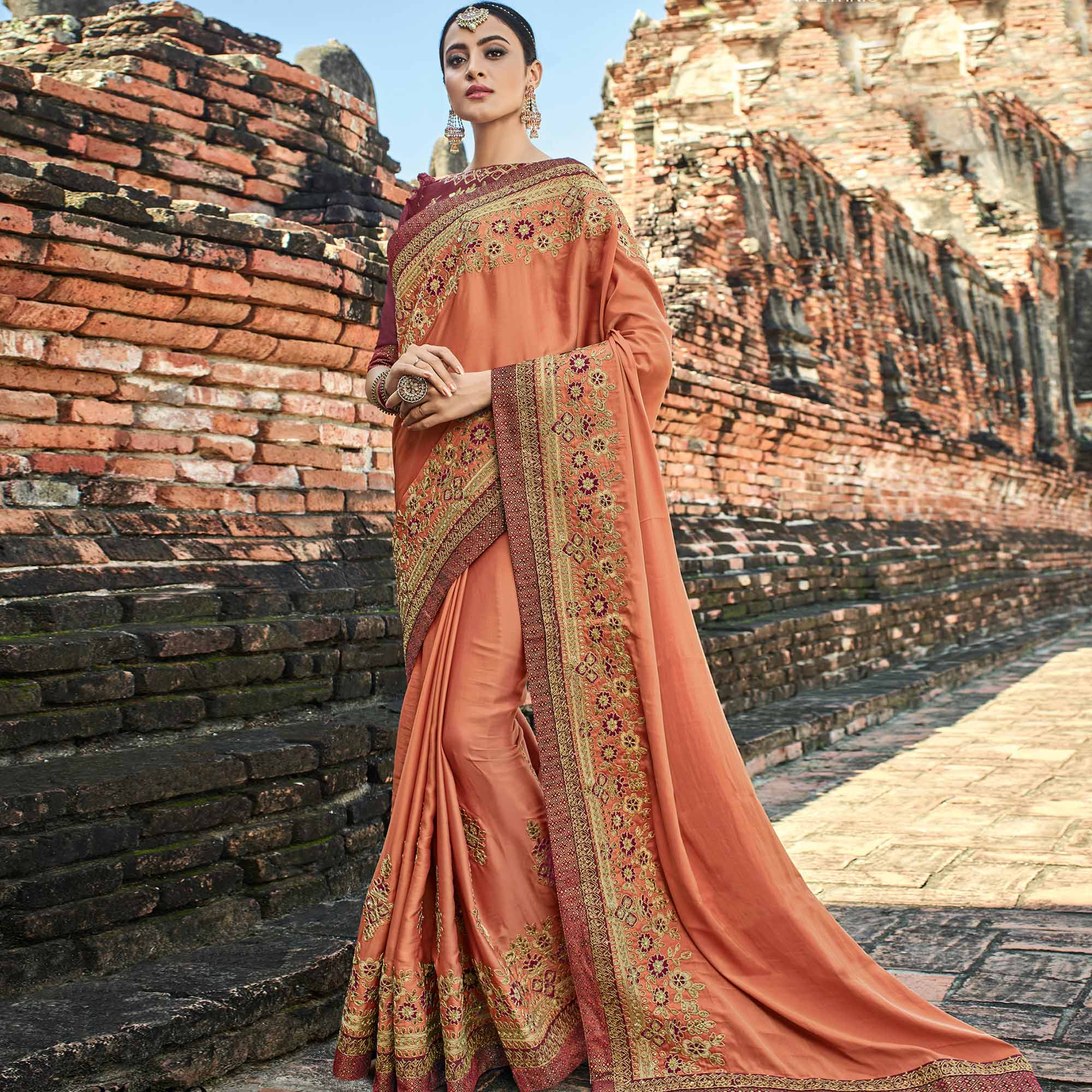 Excellent Peach Colored Party Wear Embroidered Raw Silk Saree