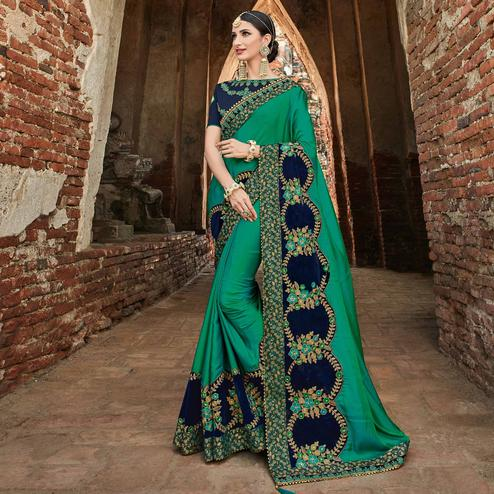 Starring Green Colored Party Wear Embroidered Raw Silk Saree