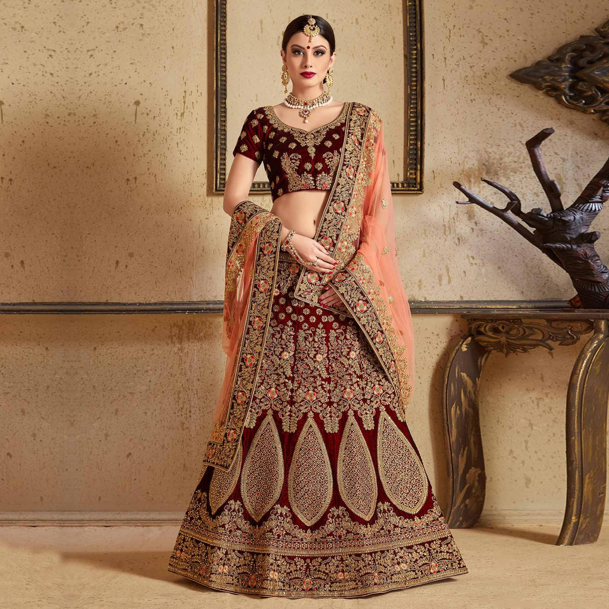 Magnetic Maroon Colored Partywear Embroidered Pure Velvet Lehenga Choli