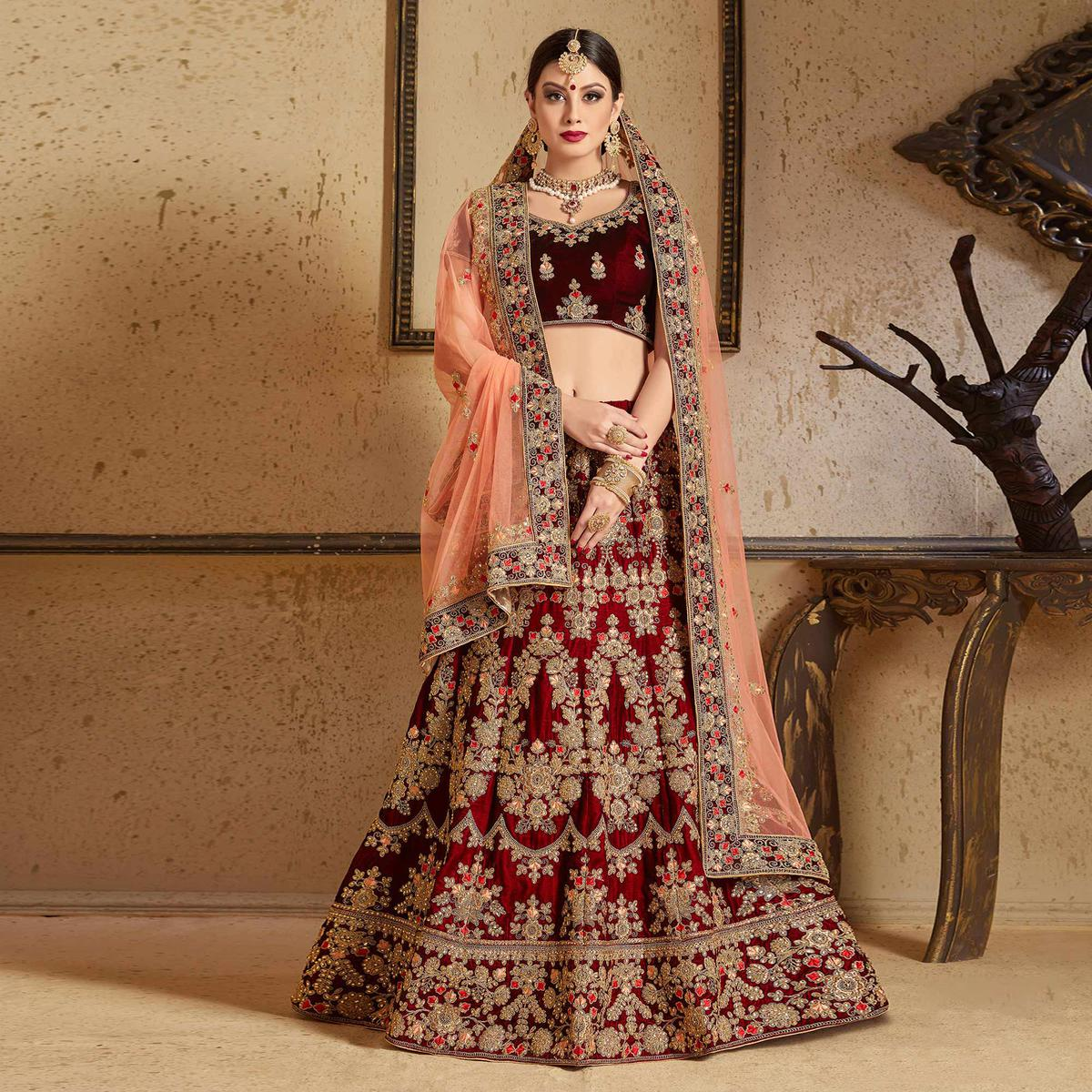 Energetic Maroon Colored Partywear Embroidered Pure Velvet Lehenga Choli