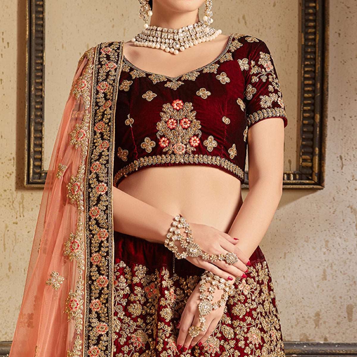 Flaunt Maroon Colored Partywear Embroidered Pure Velvet Lehenga Choli