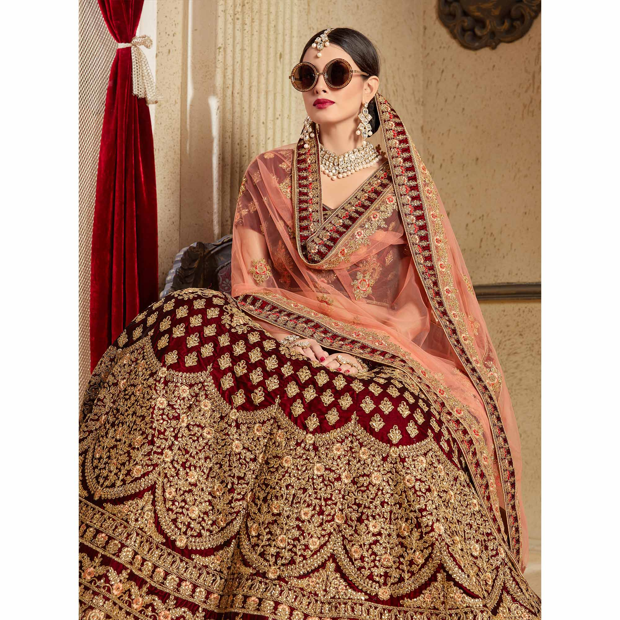 Flamboyant Maroon Colored Partywear Embroidered Pure Velvet Lehenga Choli