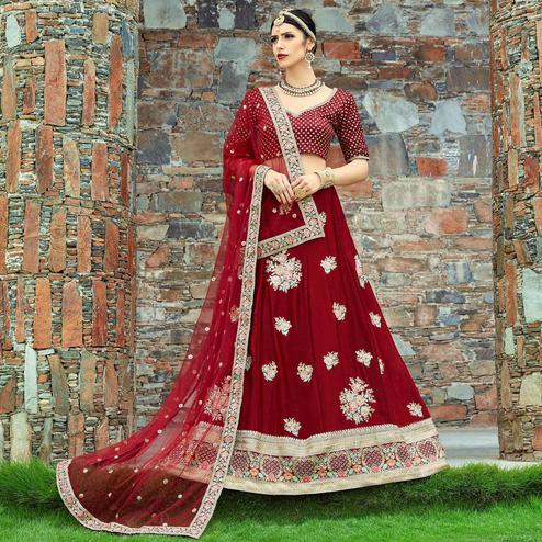 Capricious Maroon Colored Wedding Wear Embroidered Velvet Silk Lehenga Choli