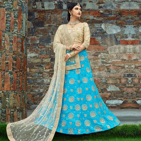 Captivating Sky Blue Colored Wedding Wear Embroidered Velvet Silk Lehenga Choli