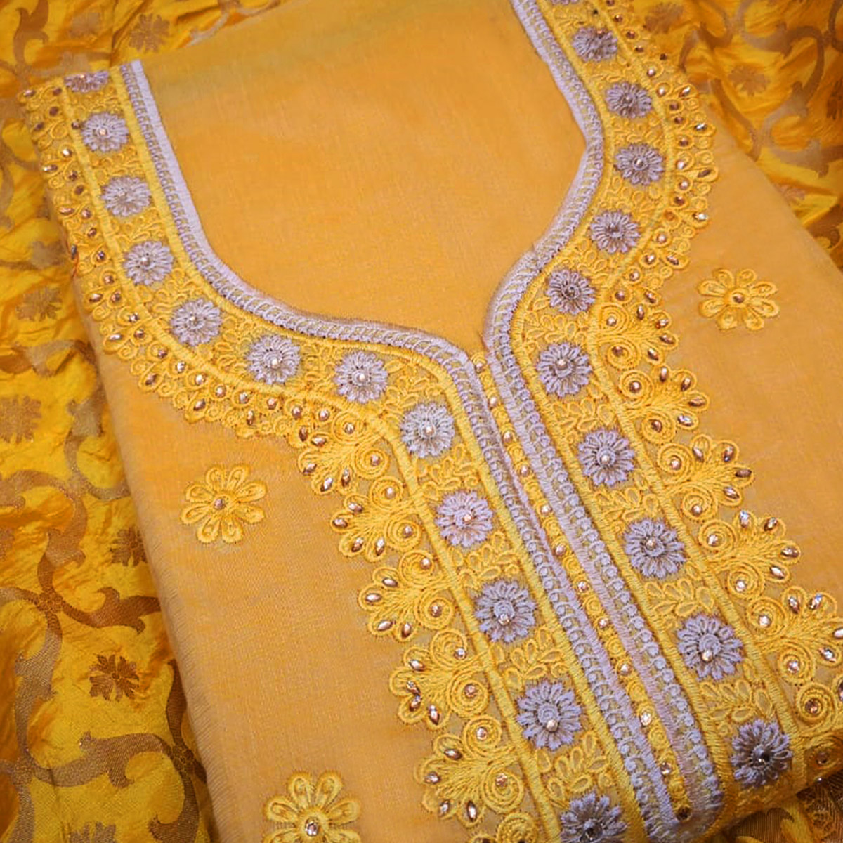 Beautiful Yellow Colored Partywear Embroidered Modal Dress Material